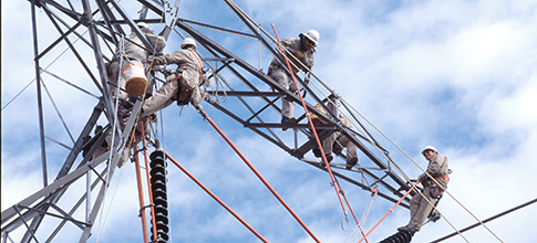 Lineworkers on transmission structure